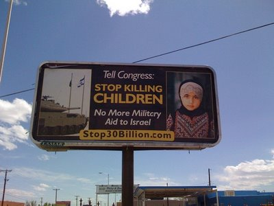 This has been confirmed to be a real billboard, put out by a group headed by Cindy Sheehan, which is funded by Hamas affiliated Holy Land Foundation